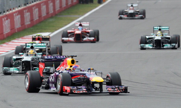 Red Bull driver Sebastian Vettel of Germany (C) leads Mercedes driver Lewis Hamilton of Britain during the Formula One Korean Grand Prix in Yeongam on October 6, 2013.  AFP PHOTO/ Prakash SINGH        (Photo credit should read PRAKASH SINGH/AFP/Getty Images)